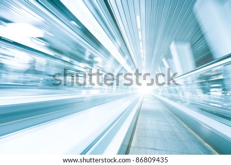 reflection of vanishing blue moving escalator in office center - stock photo