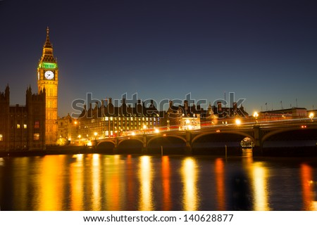 Reflection of Westminster Bridge and the Elizabeth Tower (Big Ben) of the Palace of Westminster in the River Thames