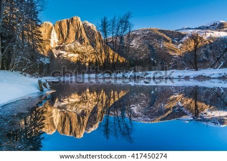 Reflection of Yosemite Falls in Winter, Yosemite National Park, USA - stock photo