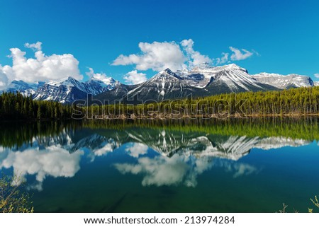 Reflection on Lake Hector in the Canadian Rockies - stock photo