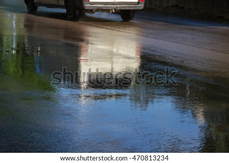 Reflection on slippery road after rain.