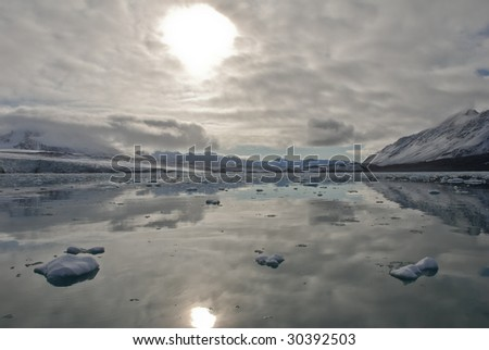 Reflection on Spitsbergen island, Arctic . - stock photo