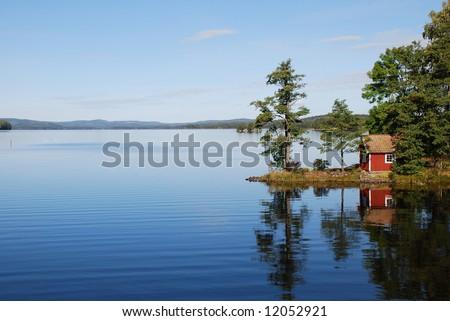 Reflection on still lake - stock photo