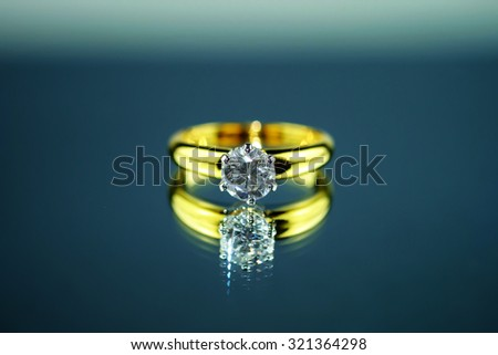 Reflection ring gold with diamond  - stock photo
