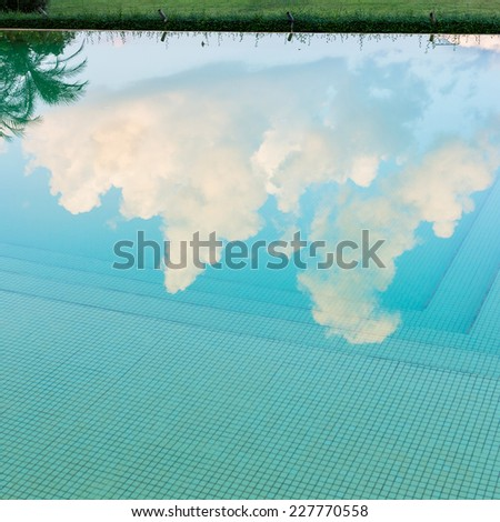 reflection sky and tree of water in swimming pool - stock photo