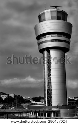 Reflections at airport in cloudy day black and white closeup - stock photo