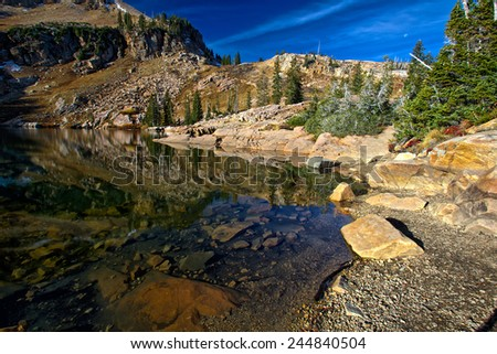 Reflections from Cecret Lake in Utah - stock photo