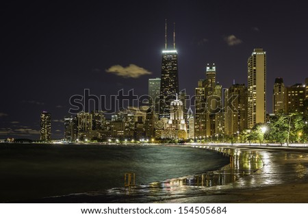 Reflections from Chicago Downtown at night - stock photo