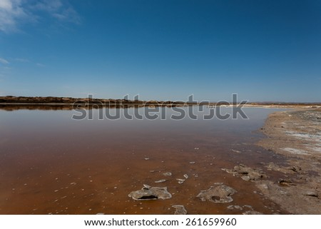 Reflections from Ugab river mouth, Skeleton Coast, Namibia - stock photo