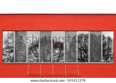 reflections in a red facade - stock photo