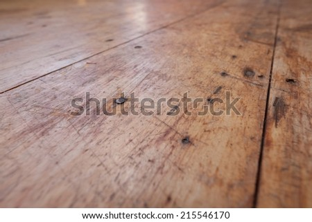 Reflections in an old barn wood floor - stock photo