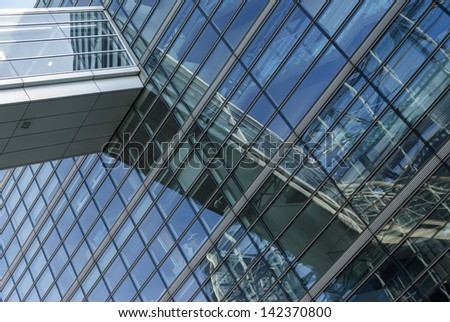 Reflections in Modern Glass Building - stock photo