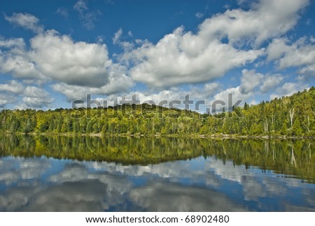 reflections in the lake - stock photo