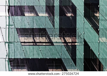 Reflections of a new office building in business center in abstract style