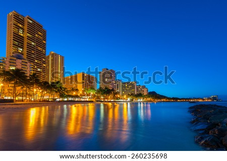 Reflections of buildings in the Pacific Ocean in the morning - stock photo