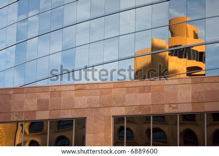 Reflections of buildings on the glass of another building