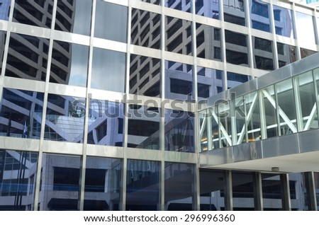 reflections of financial center building of modern architectural style and skyway abstract - stock photo