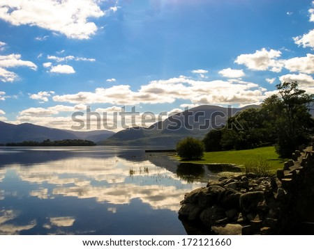 Reflections of the sky in mountains in a Lake near Killarney, Eire