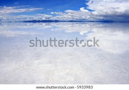 reflections on the bolivian salt flats - stock photo