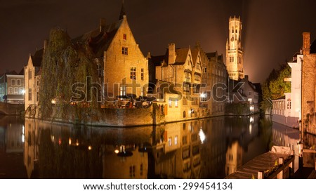 Reflections on the canals of Bruges by Night - stock photo