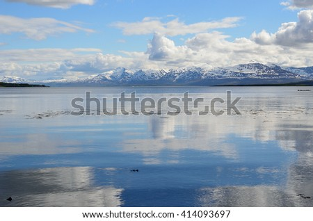 reflective fjord and snowy mountain summer landscape