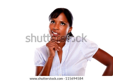Reflective or pensive young woman on white shirt at isolated background