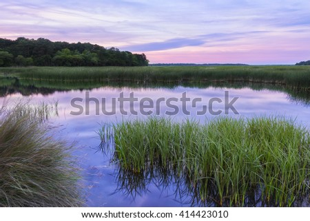 Reflective South Carolina Lowcountry Marsh Scene at Sunset in the ACE Basin - stock photo