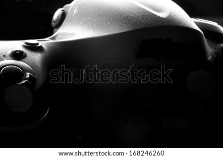 Reflex Camera isolated on black. Professional DSLR silhouette. - stock photo