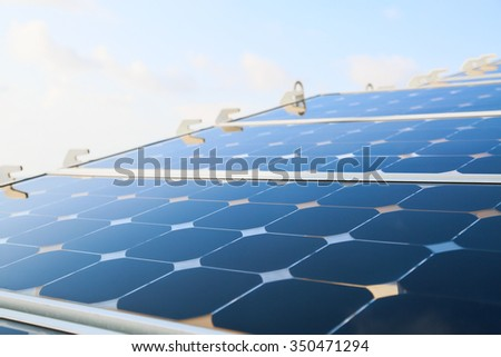 Reflex of the sky on the solar cell or photovoltaic modules, background of photovoltaic modules for renewable energy, green energy. - stock photo