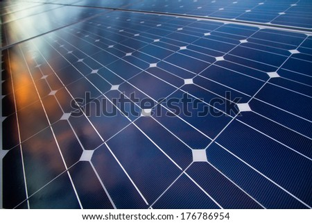 Reflexion of the clouds on the mono-crystalline photovoltaic modules
