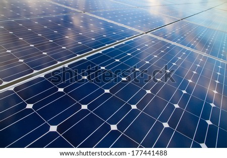 Reflexion of the clouds on the photovoltaic modules - stock photo