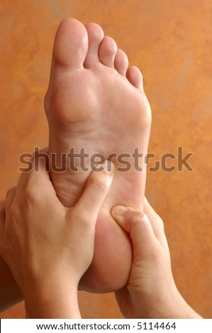 Reflexology Foot Massage at Wellness Center - stock photo