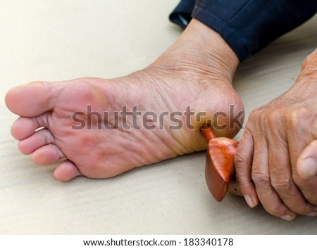 reflexology foot massage, Spa treatment yourself. - stock photo