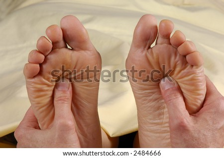Reflexology Foot Massage Treatment Both Feet - stock photo