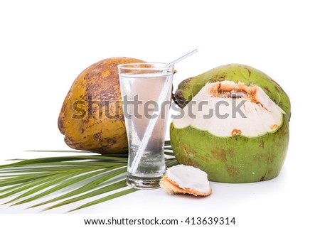 Refreshing and cold green coconut fruit juice in glass on white background