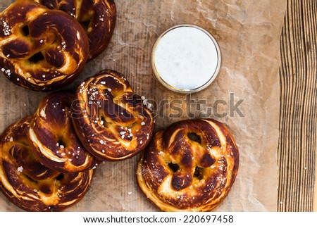 Refreshing beer ready to drink and fresh bavarian pretzels view from top. Traditional food and drink for german Oktoberfest - stock photo