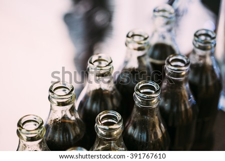 Refreshing Brown Soda in bottles in Candy Bar On Table. Delicious sweet buffet. - stock photo
