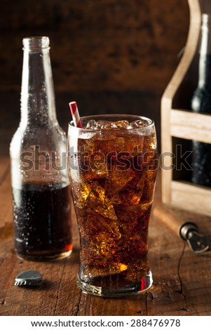 Refreshing Bubbly Soda Pop with Ice Cubes - stock photo