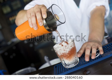 Refreshing cocktail in a summer bar - stock photo