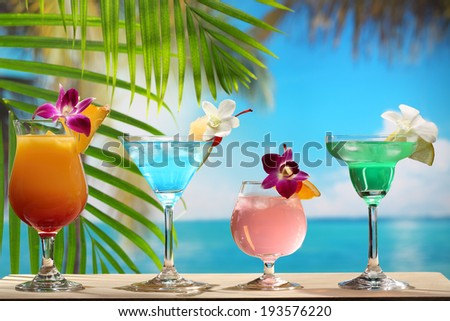 Refreshing cocktail on beach table. - stock photo