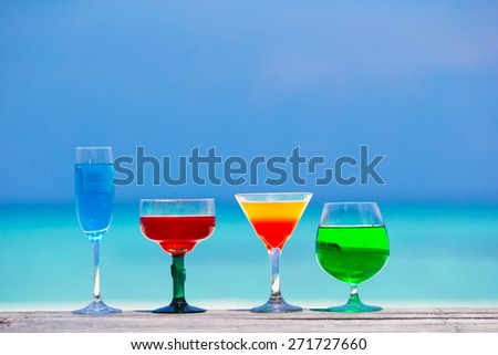 Refreshing cocktail on beach table - stock photo