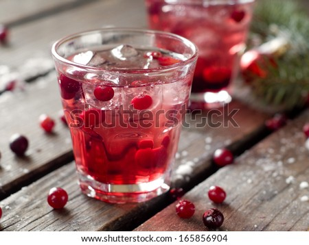 Refreshing cocktail with sparkling water with ice and cranberry, selective focus - stock photo