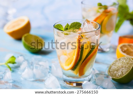 refreshing cold citrus water with mint - stock photo