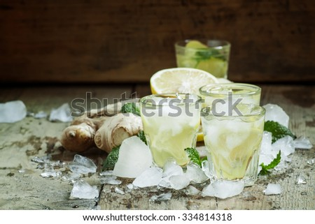 refreshing cold drink with ginger, lemon, ice and mint, selective ...