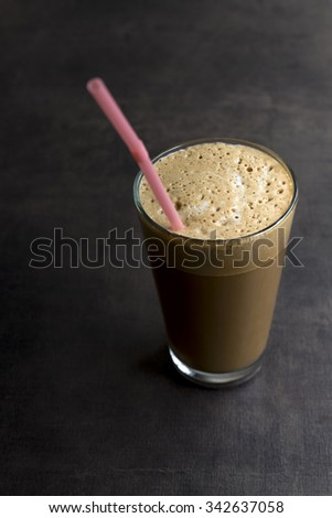 Refreshing cold frappe coffee on table - stock photo