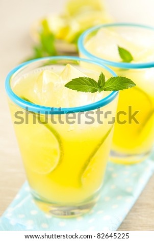 Refreshing Cold Lemonade Drink with Mint and Lime