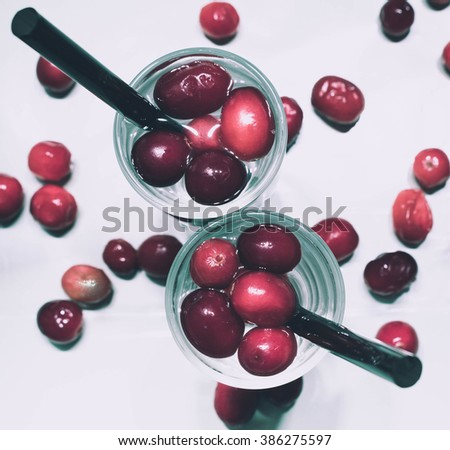 Refreshing drinks with red berries on a white background. Top view.