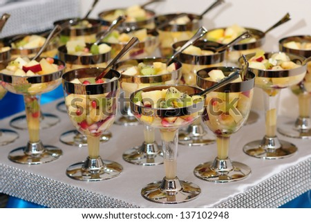 Refreshing fruit salads served in glass - stock photo