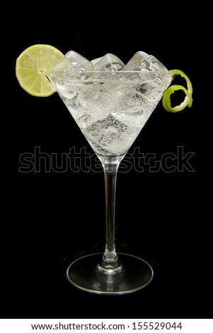 refreshing gin tonic on black background - stock photo