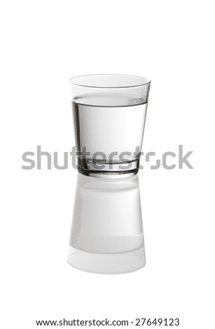Refreshing glass of water on reflective surface